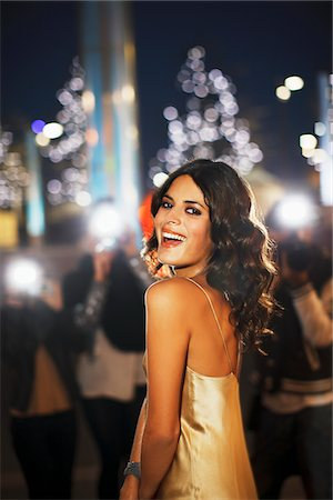 Paparazzi taking smiling celebrity's picture Stock Photo - Premium Royalty-Free, Code: 635-05550099