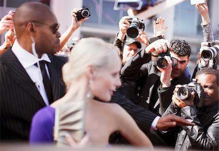 Bodyguard protecting celebrity from paparazzi Stock Photo - Premium Royalty-Free, Code: 635-05550090