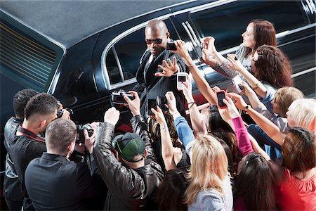 Bodyguard protecting celebrity from paparazzi Stock Photo - Premium Royalty-Free, Code: 635-05550107