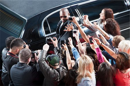 Bodyguard protecting celebrity from paparazzi Stock Photo - Premium Royalty-Free, Code: 635-05550107