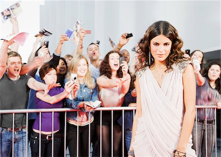 Fans reaching towards celebrity on red carpet Stock Photo - Premium Royalty-Free, Code: 635-05550101