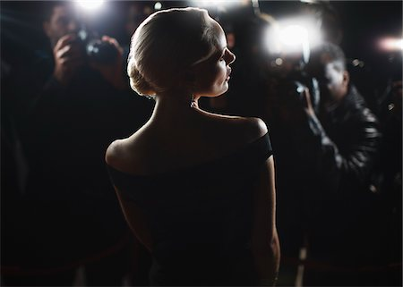 Celebrity posing for paparazzi Stock Photo - Premium Royalty-Free, Code: 635-05550114