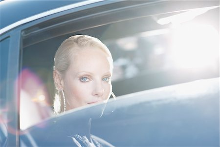 Celebrity sitting in backseat of car Stock Photo - Premium Royalty-Free, Code: 635-05550127