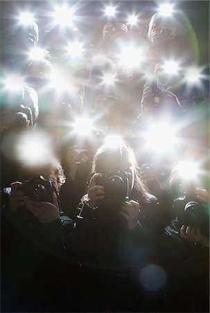 Paparazzi taking pictures with flash Stock Photo - Premium Royalty-Free, Code: 635-05550141