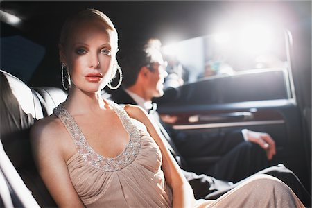 Celebrity sitting in backseat of car Stock Photo - Premium Royalty-Free, Code: 635-05550143