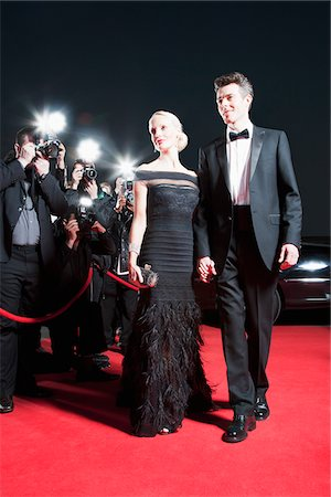 Celebrities posing for paparazzi on red carpet Stock Photo - Premium Royalty-Free, Code: 635-05550156