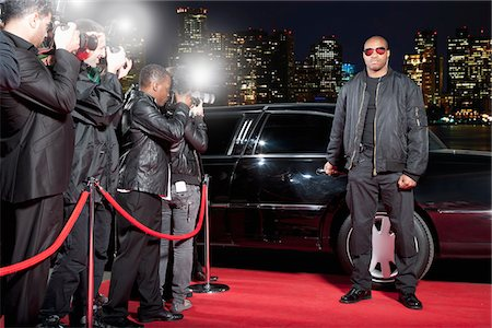 Bodyguard opening limo door on red carpet Stock Photo - Premium Royalty-Free, Code: 635-05550167