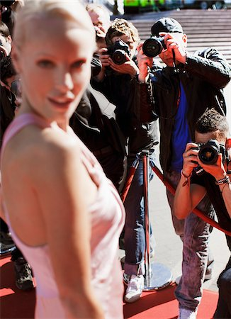 Celebrity posing for paparazzi on red carpet Stock Photo - Premium Royalty-Free, Code: 635-05550161