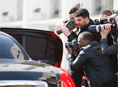 Paparazzi taking pictures of celebrity in car Stock Photo - Premium Royalty-Free, Code: 635-05550162
