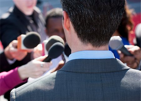 report - Politician talking into reporters' microphones Stock Photo - Premium Royalty-Free, Code: 635-05550178