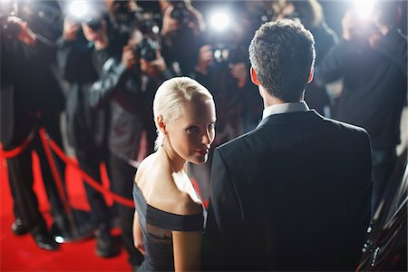 Celebrities posing for paparazzi on red carpet Stock Photo - Premium Royalty-Free, Code: 635-05550171