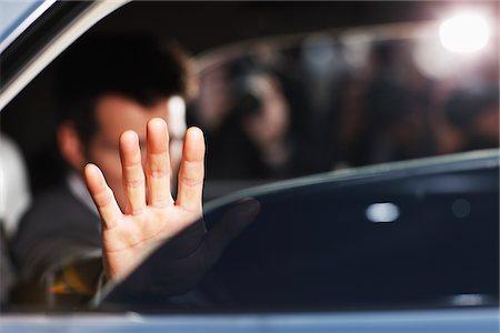 Man blocking photo in backseat of car Stock Photo - Premium Royalty-Free, Code: 635-05550187