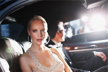 Celebrities posing for paparazzi in backseat of car Stock Photo - Premium Royalty-Free, Code: 635-05550181