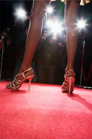 Celebrity posing for paparazzi on red carpet Stock Photo - Premium Royalty-Free, Code: 635-05550198