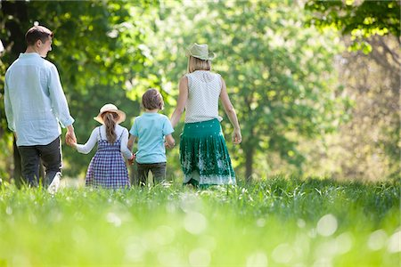 Family walking in field of flowers Stock Photo - Premium Royalty-Free, Code: 635-05550204