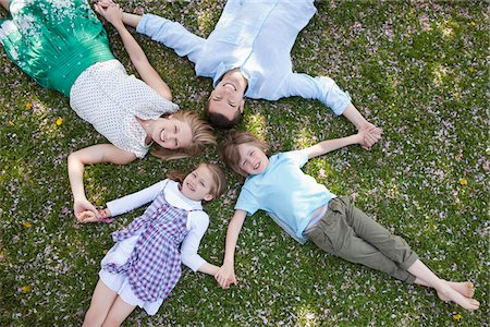 Family laying in grass together Stock Photo - Premium Royalty-Free, Code: 635-05550215