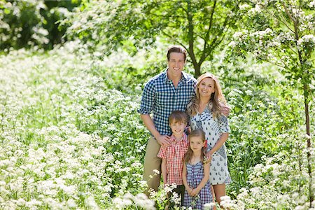 Family standing together in field of flowers Stock Photo - Premium Royalty-Free, Code: 635-05550246