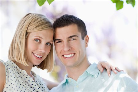 Couple smiling together outdoors Stock Photo - Premium Royalty-Free, Code: 635-05550240