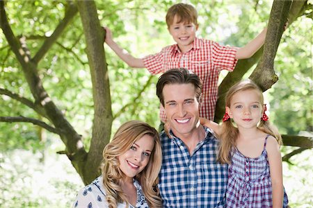 Family standing under tree outdoors Stock Photo - Premium Royalty-Free, Code: 635-05550255