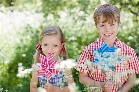 Children playing with pinwheels in park Stock Photo - Premium Royalty-Free, Code: 635-05550268