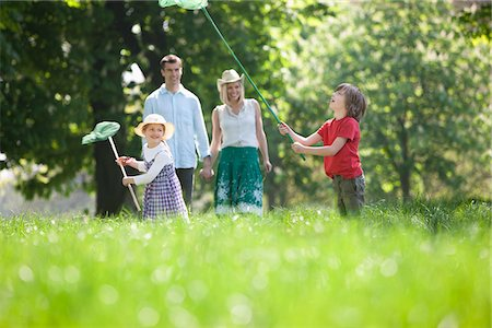 Family playing in park Stock Photo - Premium Royalty-Free, Code: 635-05550278