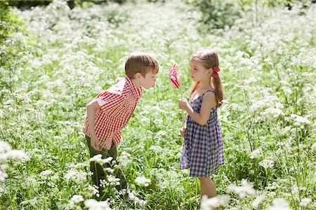 floral - Children playing with pinwheel in field of flowers Stock Photo - Premium Royalty-Free, Code: 635-05550283