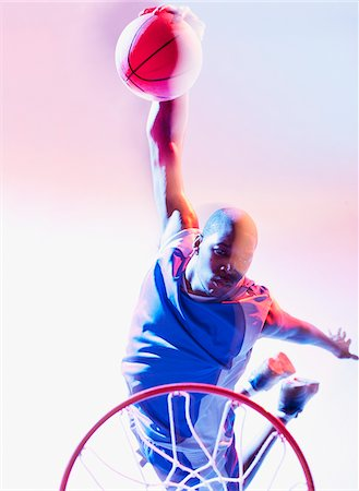 Blurred view of basketball player dunking Stock Photo - Premium Royalty-Free, Code: 635-05550489