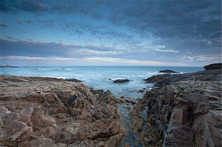 Rocks jutting into ocean under dramatic sky Stock Photo - Premium Royalty-Free, Code: 635-05550480
