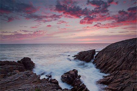 Rocks jutting into ocean under dramatic sky Stock Photo - Premium Royalty-Free, Code: 635-05550481