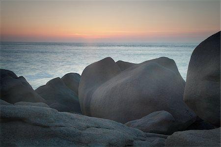 Rocks on beach at sunset Stock Photo - Premium Royalty-Free, Code: 635-05550483