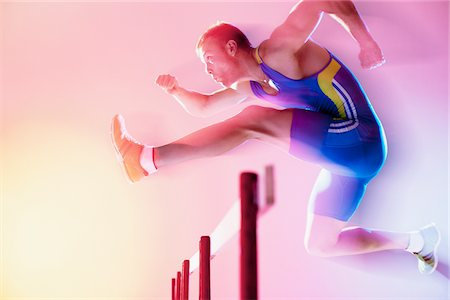 Blurred view of athlete jumping hurdles Stock Photo - Premium Royalty-Free, Code: 635-05550574