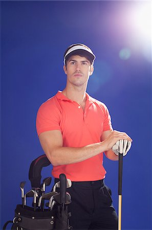 Golf player with club and golf bag Stock Photo - Premium Royalty-Free, Code: 635-05550571