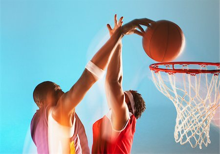 scoring - Blurred view of basketball player dunking Stock Photo - Premium Royalty-Free, Code: 635-05550583
