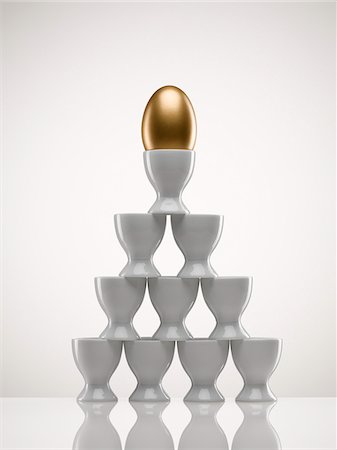 Stacked egg cups with golden egg Stock Photo - Premium Royalty-Free, Code: 635-05550664