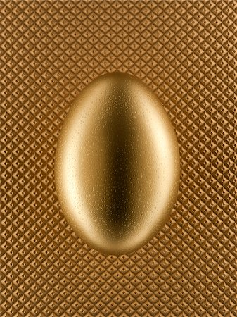 Close up of golden egg Stock Photo - Premium Royalty-Free, Code: 635-05550663