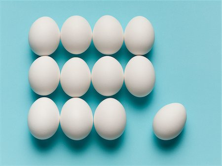 Egg rolling away from grid Stock Photo - Premium Royalty-Free, Code: 635-05550675