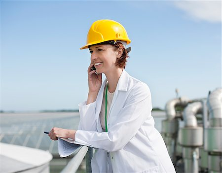 farm phone - Scientist talking on cell phone outdoors Stock Photo - Premium Royalty-Free, Code: 635-05550746