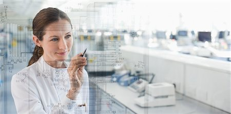 science & technology - Scientist using touch screen in lab Stock Photo - Premium Royalty-Free, Code: 635-05550809