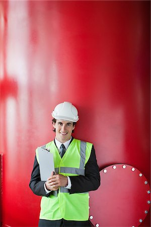 Businessman leaning on tank Stock Photo - Premium Royalty-Free, Code: 635-05550827