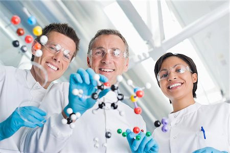production - Scientists examining molecular models in lab Stock Photo - Premium Royalty-Free, Code: 635-05550911