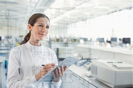science & technology - Scientist using clipboard and touch screen in lab Stock Photo - Premium Royalty-Free, Code: 635-05550912