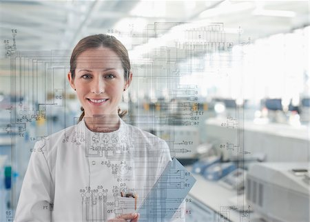 Scientist using touch screen in labs Stock Photo - Premium Royalty-Free, Code: 635-05551000