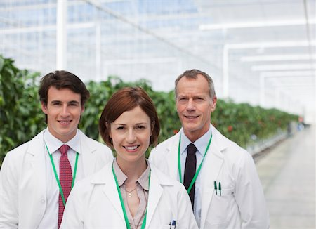 Scientists smiling in greenhouse Stock Photo - Premium Royalty-Free, Code: 635-05551002