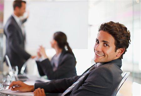 superior - Businessman smiling at desk Stock Photo - Premium Royalty-Free, Code: 635-05551031