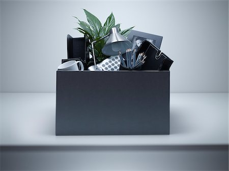 Box packed with desk objects Stock Photo - Premium Royalty-Free, Code: 635-05551075