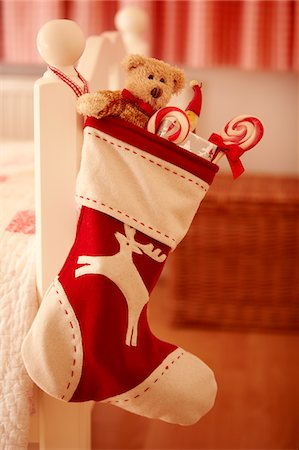 sweet   no people - Close up of Christmas stocking hanging from bed Stock Photo - Premium Royalty-Free, Code: 635-05551081