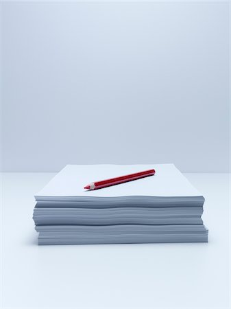 Red pencil on stack of paper Stock Photo - Premium Royalty-Free, Code: 635-05551082