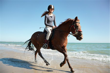 Girl riding horse on beach Stock Photo - Premium Royalty-Free, Code: 635-05551108