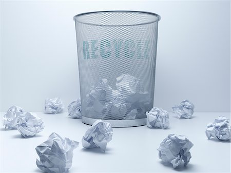 Crumpled balls of paper beside recycling bin Stock Photo - Premium Royalty-Free, Code: 635-05551100