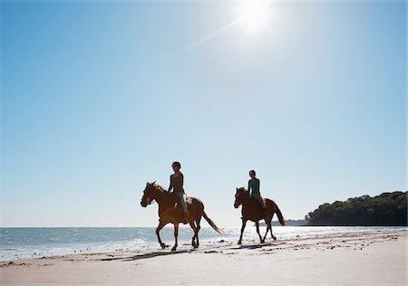 Girls riding horses on beach Stock Photo - Premium Royalty-Free, Code: 635-05551119